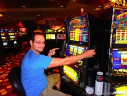 Pavel playing coin machines in Vegas